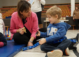 Director of Education Lisa Walsh engages with a future kindergarten student at a CATYO event